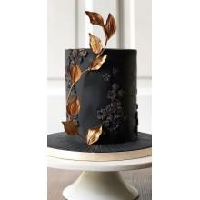 Торт черный с золотыми листьями стильный